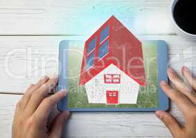 red roof house on tablet. with table