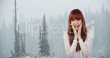 Female hipster with hands on cheeks screaming against trees in foggy weather