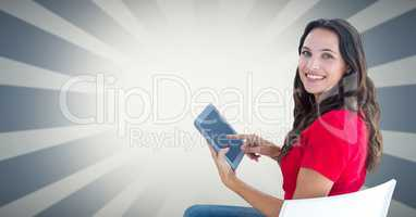 Smiling woman using tablet PC against bright background