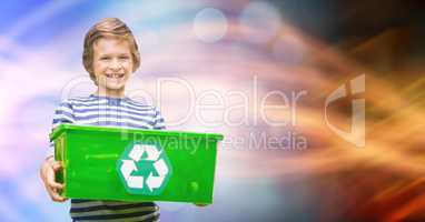 Little boy carrying recycle container