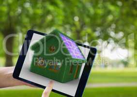 grass house on tablet. in the park