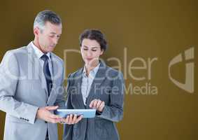 Business people using tablet PC over colored background
