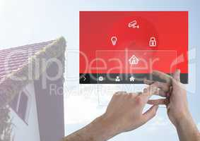 Hand touching a tablet and a home automation system App Interface