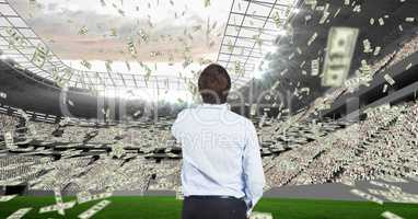 Rear view of businessman with money flying representing corruption