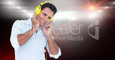 Smiling businessman listening to songs on headphones