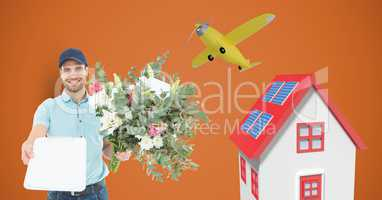 Delivery man holding clipboard and flowers by house and airplane