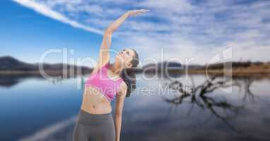 Double exposure of woman performing yoga at lakeshore