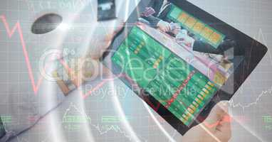 Hands holding digital tablet displaying data with overlay
