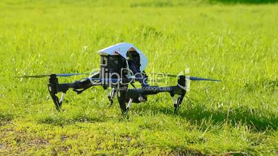 Drone takes off with green grass up, composed chassis and flies forward