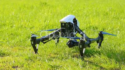 Drone takes off with green grass up, composed chassis and flies up out of frame