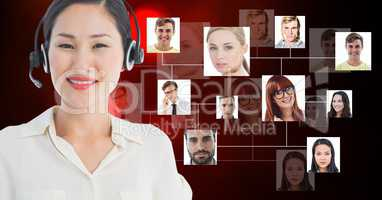 Smiling female customer care representative wearing microphone against flying business portraits