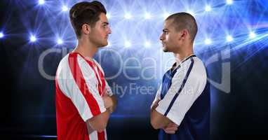 Soccer players looking at each other at stadium