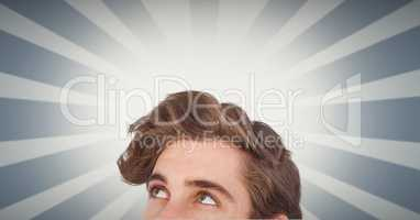 Male hipster looking up against illuminated background