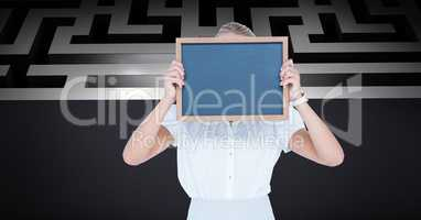 Businesswoman holding slate in front of face