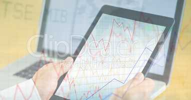 Business person holding digital tablet with graph overlay