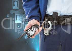 Midsection of security guard holding radio