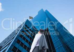 businessman looking up to see the checker flag in a building