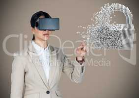 Business woman in VR touching 3D lock graphic against brown background