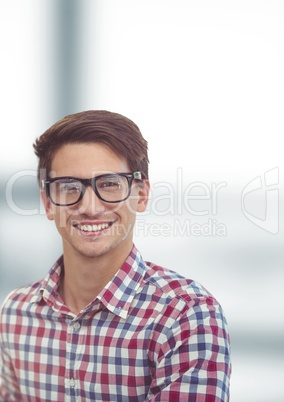 Portrait of happy male hipster over blurred background