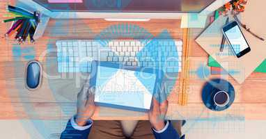 Digitally generated image of businessman holding tablet PC