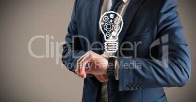 Business man mid section with lightbulb doodles over watch against brown background