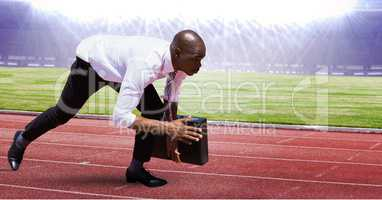 Digital composite image of businessman at starting point on racing track