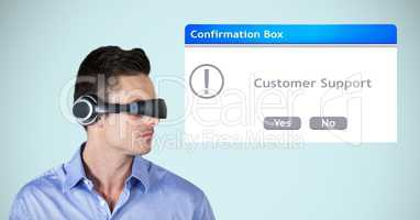 Businessman wearing VR headphones by confirmation box