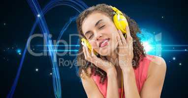 Young woman enjoying music on headphones