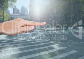 Hand Touching air of city street