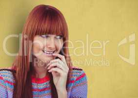 Happy redheaded female hipster looking away against yellow background