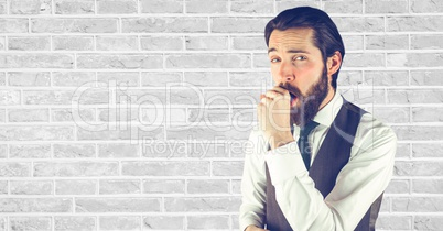 Hipster coughing against wall