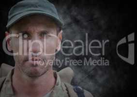 Transparent soldier face against black grunge background