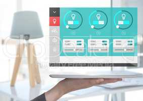 Hand holding tablet and a Home automation system lighting App Interface