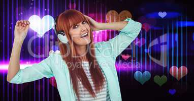 Happy female listening songs on headphones with heart shapes in background