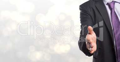 Midsection of businessman offering handshake