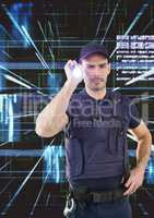 Security guard using flashlight against abstract background