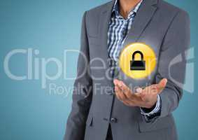 Business man mid section with yellow lock graphic and flare in hand against blue background