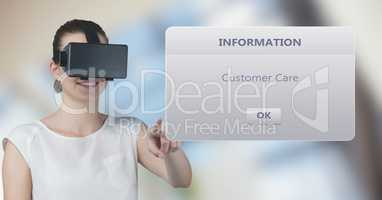 Smiling woman wearing VR glasses while touching information box