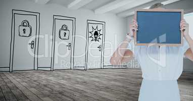 Businesswoman holding slate against drawn doors