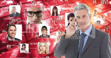 Digitally generated image of businessman using smart phone against portraits