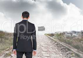 businessman in a road going to catch the checker flag