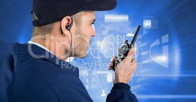 Security guard using radio against screen