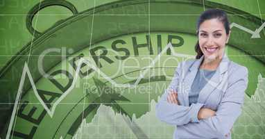 Confident businesswoman with arms crossed against leadership clock
