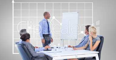 Businessman giving presentation to colleagues against graph
