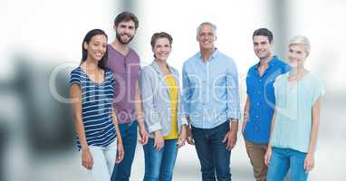 Portrait of happy friends standing against blurred background