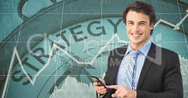Smiling businessman with smart phone against strategy clock