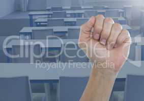 Hand in fist in classroom