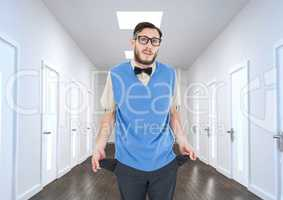Young businessman with empty pockets in office