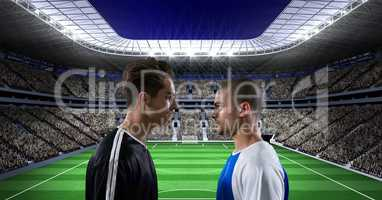 Sportsmen looking at each other on soccer field