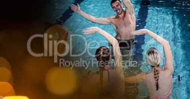 Man and women exercising in swimming pool